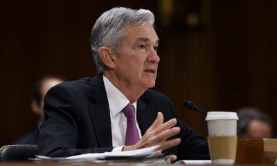 Powell says economy is 'a long way' from Fed's goals and central bank has no plans to raise interest rates or reduce bond purchases